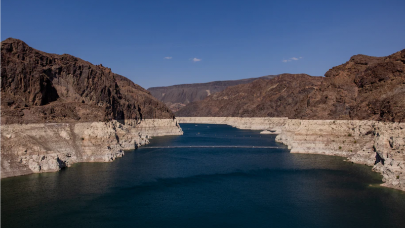 The deposition of minerals on previously submerged surfaces marked on the shoreline of the Colorado River during low water levels in Arizona on Aug. 19. (Roger Kisby/Bloomberg News)